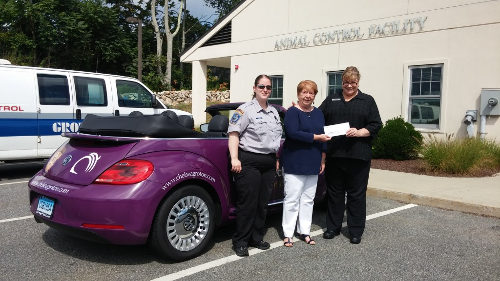Standing next to the Chelsea Groton car are Animal Control Officer Christine O'Brien, GAF President Mary Kelly, and Karen Ventura, presenter of the check from Chelsea Bank.